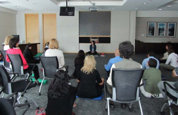 Wendy leading meditation in the workplace